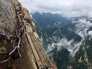 5 of the World's Most Daring Travel Experiences | Huashan Mountain Plank